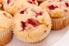Strawberry Muffin. Homemade strawberry muffins made with buttermilk and frozen berries. Selective focus with shallow DOF Stock Images