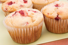 Strawberry Muffins. Homemade strawberry muffins. Made with buttermilk and frozen berries. shallow DOF. Shot in natural day light Royalty Free Stock Image