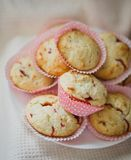 Strawberry muffins. On a plate near dishcloth Stock Images
