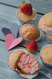 Strawberry muffins. On wooden background and heart note Stock Photos