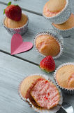 Strawberry muffins. On wooden background and heart note Stock Images