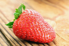 Strawberry on a old wooden table Royalty Free Stock Photo