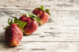 Strawberry on a old wooden table Stock Photography