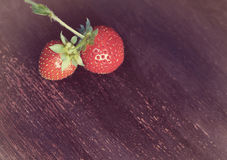 Strawberry on old wooden table Royalty Free Stock Image