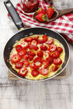 Strawberry omelette on frying pan Royalty Free Stock Photography