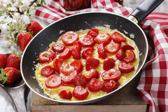 Strawberry omelette on frying pan Royalty Free Stock Photo