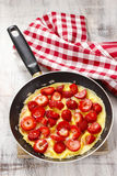 Strawberry omelette on frying pan Stock Photography