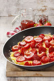 Strawberry omelette on frying pan Royalty Free Stock Images