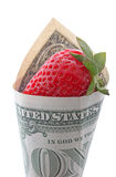 Strawberry in one dollar Stock Photos