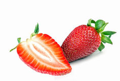 Strawberry with one slice Royalty Free Stock Images