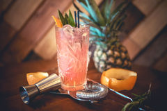 Strawberry orange alcoholic cocktail with lime and orange, served as refreshment drink in local pub Stock Image