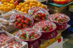 Strawberry and Orange in the night market. Some raw and fresh strawberry and orange in the night market Stock Image