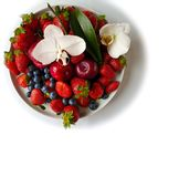 Strawberry With orchid on White Plate royalty free stock photos