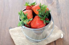 Strawberry. A pail of fresh strawberry on the table stock image