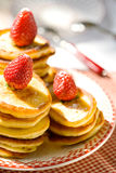 Strawberry pancakes. Stack of pancakes with fresh strawberries on plate royalty free stock image