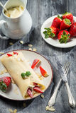 Strawberry pancakes with whipped cream and mint leaf Stock Photo