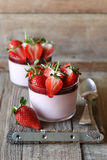 Strawberry panna cotta. Homemade strawberry panna cotta on wooden board Royalty Free Stock Images