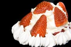 Strawberry pavlova. Stawberry pavlova with fresh cream and strawberries on a black background Stock Image