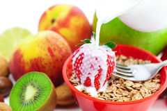 Strawberry, peach, apple, kiwi, fork, milk, flakes Royalty Free Stock Photography