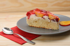 Strawberry and peach cake with gelatin on grey plate on wooden t Stock Photography