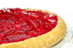Strawberry pie. Closeup of a delicious strawberry pie. Blends to white Stock Photography