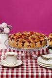 Strawberry pie on cake stand, fuchsia background Royalty Free Stock Photos