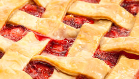 Strawberry Pie. Close up of a delicious homemade Strawberry Rhubarb Pie with basket weave style crust stock photos