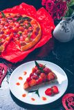 Strawberry pie on white plate black wooden table. One piece.  Romantic. Love. Heart. Toned photo. Valentine Day Royalty Free Stock Image
