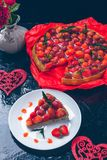 Strawberry pie on white plate black wooden table. One piece.  Romantic. Love. Heart. Toned photo. Valentine Day Royalty Free Stock Photo