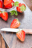 Strawberry Pieces. Portion of Strawberry Pieces with some fresh fruits (close-up shot Royalty Free Stock Images