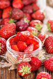 Strawberry Pieces. Portion of Strawberry Pieces with some fresh fruits (close-up shot Royalty Free Stock Image