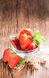 Strawberry Pieces. Portion of Strawberry Pieces with some fresh fruits (close-up shot Stock Photos