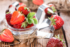 Strawberry Pieces. Portion of Strawberry Pieces with some fresh fruits (close-up shot Royalty Free Stock Photography