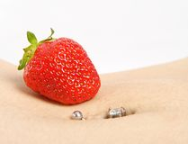 Strawberry Piercing Royalty Free Stock Photography