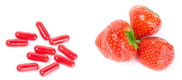 Strawberry and pills - nature vs science Stock Photo