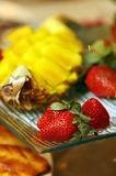 Strawberry and pineapple Stock Images