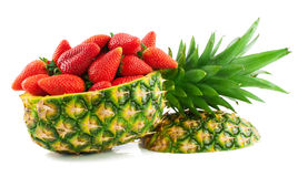 Strawberry and pineapple. Pineapple  carved into a basket filled   with strawberry  on white background Stock Image