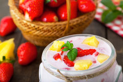 Strawberry and pineapple flavored yogurt Royalty Free Stock Photo