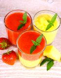 Strawberry and pineapple smoothie in glass mixed Stock Photos