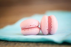 Strawberry pink macaron. French strawberry macarons on a turquoise fabric Royalty Free Stock Photo