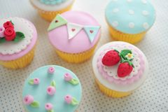 Strawberry fondant cup cakes. Strawberry and pink rose fondant cup cakes royalty free stock photos