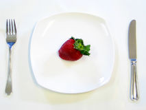 Strawberry On A Plate Royalty Free Stock Images