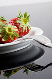 Strawberry and plate Stock Photography