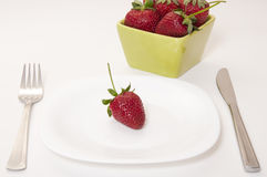 Strawberry in the plate. Strawberries on a plate with cutlery Stock Photo