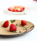 Strawberry  in  plate. Strawberry in a  color plate Stock Image