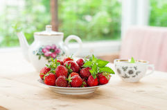 Strawberry in a plate with melissa Stock Photo