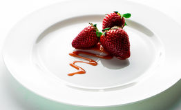 Strawberry. The strawberry on a plate whit dressing Royalty Free Stock Photography