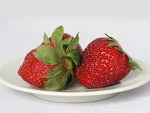 Strawberry on a plate stock images