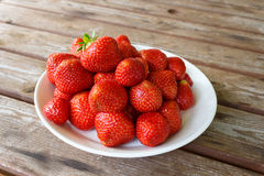 Strawberry plate on the wooden table Stock Photo