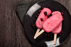 Strawberry popslice icecream on dark background Royalty Free Stock Photography